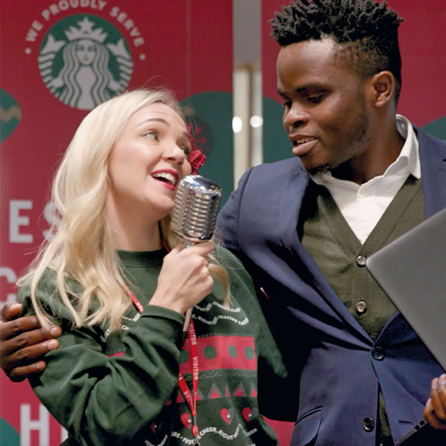 Two people singing at a hot beverage sampling event